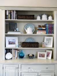stacked books & ornaments - http://too-much-time.com/